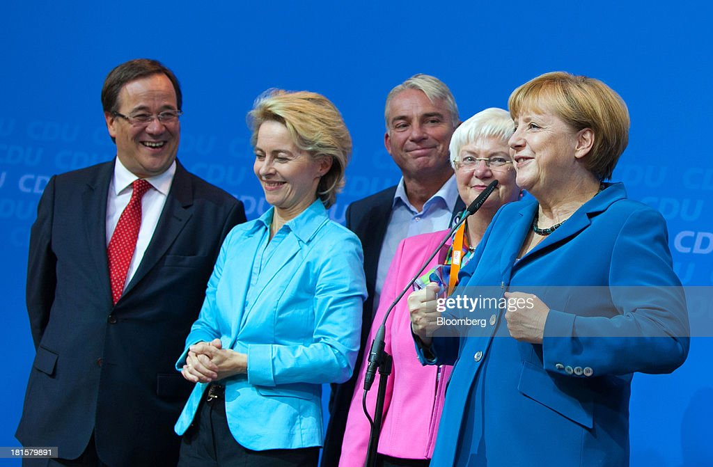 Angela Merkel, Germany's chancellor and party leader of the Christian Democratic Union (CDU), right, speaks next to Armin Laschet, CDU regional party chairman, from left, Ursula von der Leyen, Federal Minister of Labour, Thomas Strobl, Baden-Württemberg state CDU party chairman, and Gerda Hasselfeldt, head of the Christian Social Union, at the CDU headquarters as the German federal elections result is announced in Berlin, Germany, on Sunday, Sept. 22, 2013. Merkel won an overwhelming endorsement from German voters, putting the country's first female chancellor on course for the biggest election tally since Helmut Kohl's post-reunification victory of 1990. Photographer: Krisztian Bocsi/Bloomberg via Getty Images