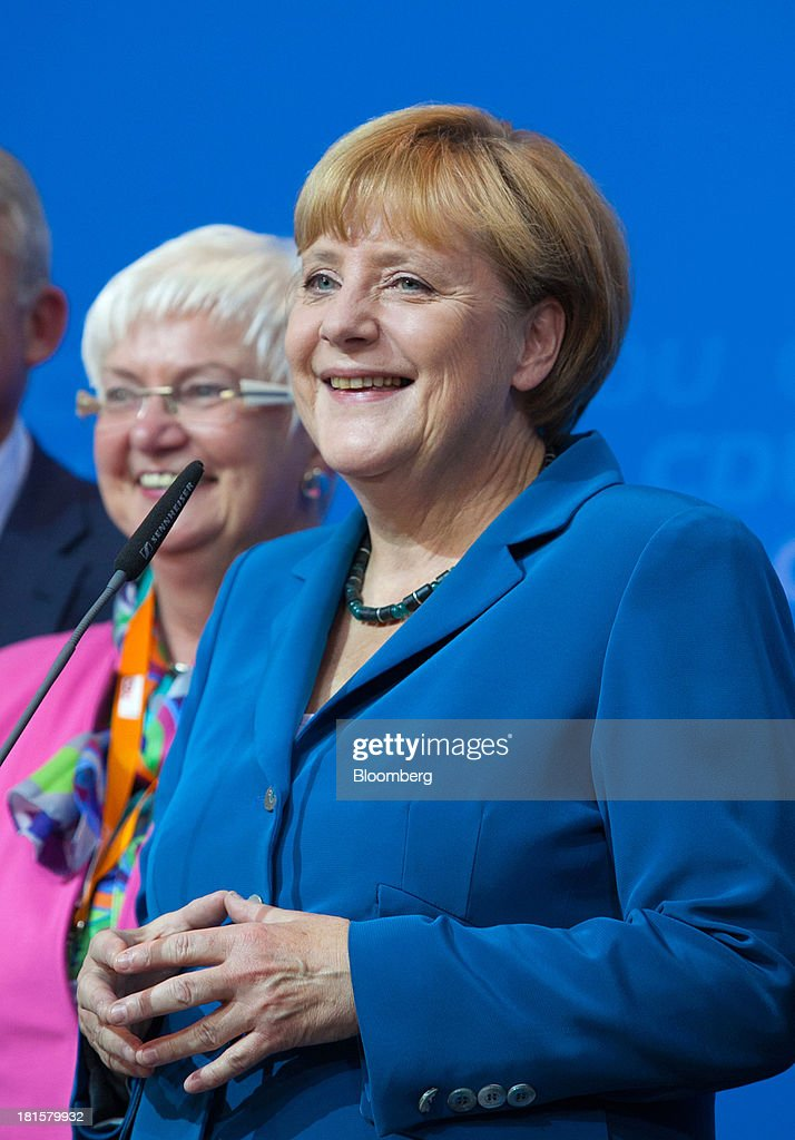 Angela Merkel, Germany's chancellor and party leader of the Christian Democratic Union (CDU), speaks next to Gerda Hasselfeldt, head of the Christian Social Union, left, at the CDU headquarters after the German federal elections initial results were announced in Berlin, Germany, on Sunday, Sept. 22, 2013. Merkel won an overwhelming endorsement from German voters, putting the country's first female chancellor on course for the biggest election tally since Helmut Kohl's post-reunification victory of 1990. Photographer: Krisztian Bocsi/Bloomberg via Getty Images