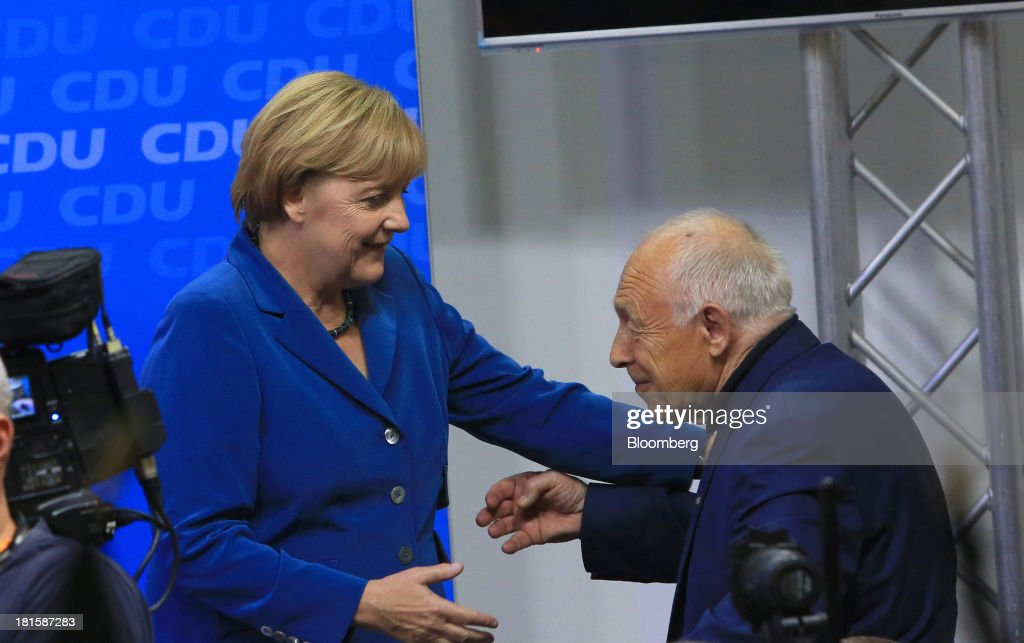 <a gi-track='captionPersonalityLinkClicked' href=/galleries/search?phrase=Angela+Merkel&family=editorial&specificpeople=202161 ng-click='$event.stopPropagation()'>Angela Merkel</a>, Germany's chancellor and party leader of the Christian Democratic Union (CDU), left, greets <a gi-track='captionPersonalityLinkClicked' href=/galleries/search?phrase=Heiner+Geissler&family=editorial&specificpeople=2638978 ng-click='$event.stopPropagation()'>Heiner Geissler</a>, former CDU secretary general, during victory celebrations at the CDU headquarters after the German federal elections results were announced in Berlin, Germany, on Sunday, Sept. 22, 2013. Merkel won an overwhelming endorsement from German voters, putting the country's first female chancellor on course for the biggest election tally since Helmut Kohl's post-reunification victory of 1990. Photographer: Krisztian Bocsi/Bloomberg via Getty Images
