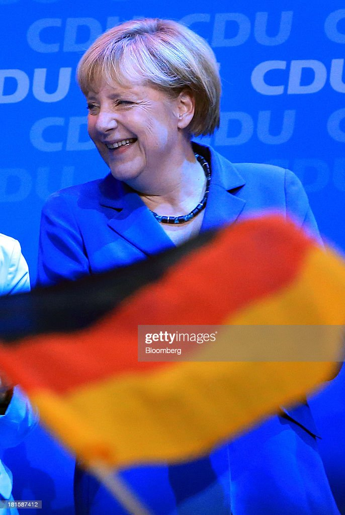<a gi-track='captionPersonalityLinkClicked' href=/galleries/search?phrase=Angela+Merkel&family=editorial&specificpeople=202161 ng-click='$event.stopPropagation()'>Angela Merkel</a>, Germany's chancellor and party leader of the Christian Democratic Union (CDU), smiles during victory celebrations at the CDU headquarters after the German federal elections results were announced in Berlin, Germany, on Sunday, Sept. 22, 2013. Merkel won an overwhelming endorsement from German voters, putting the country's first female chancellor on course for the biggest election tally since Helmut Kohl's post-reunification victory of 1990. Photographer: Krisztian Bocsi/Bloomberg via Getty Images