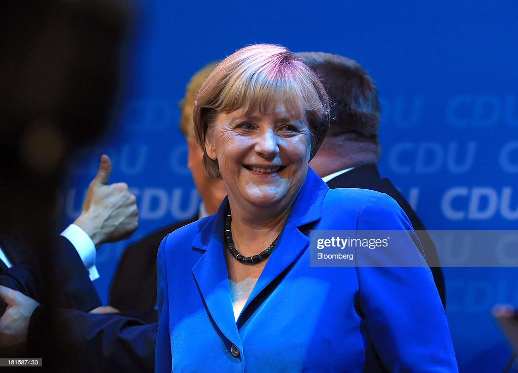 Angela Merkel, Germany's chancellor and party leader of the Christian Democratic Union (CDU), smiles during victory celebrations at the CDU headquarters after the German federal elections results were announced in Berlin, Germany, on Sunday, Sept. 22, 2013. Merkel won an overwhelming endorsement from German voters, putting the country's first female chancellor on course for the biggest election tally since Helmut Kohl's post-reunification victory of 1990. Photographer: Krisztian Bocsi/Bloomberg via Getty Images