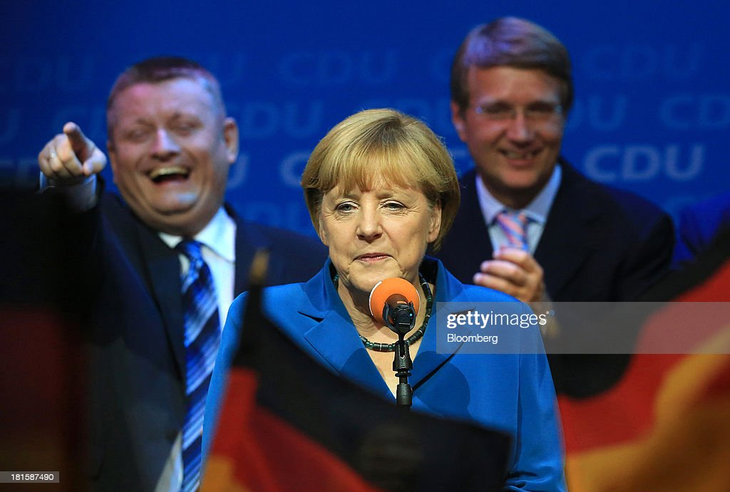 Angela Merkel, Germany's chancellor and party leader of the Christian Democratic Union (CDU), speaks with supporters on stage during victory celebrations at the CDU headquarters after the German federal elections results were announced in Berlin, Germany, on Sunday, Sept. 22, 2013. Merkel won an overwhelming endorsement from German voters, putting the country's first female chancellor on course for the biggest election tally since Helmut Kohl's post-reunification victory of 1990. Photographer: Krisztian Bocsi/Bloomberg via Getty Images