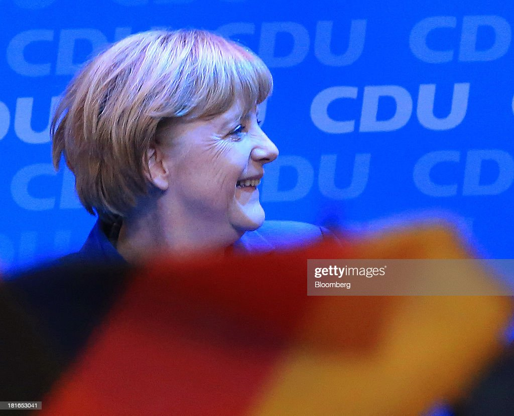 Angela Merkel, Germany's chancellor and party leader of the Christian Democratic Union (CDU), stands on stage during victory celebrations at the CDU headquarters after the German federal elections results were announced in Berlin, Germany, on Sunday, Sept. 22, 2013. Merkel won an overwhelming endorsement from German voters, putting the country's first female chancellor on course for the biggest election tally since Helmut Kohl's post-reunification victory of 1990. Photographer: Krisztian Bocsi/Bloomberg via Getty Images