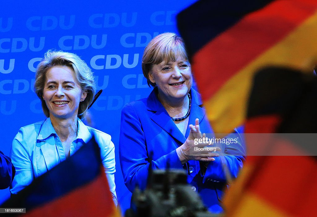 Angela Merkel, Germany's chancellor and party leader of the Christian Democratic Union (CDU), right, stands on stage beside Ursula von der Leyen, Germany's labor minister, during victory celebrations at the CDU headquarters after the German federal elections results were announced in Berlin, Germany, on Sunday, Sept. 22, 2013. Merkel won an overwhelming endorsement from German voters, putting the country's first female chancellor on course for the biggest election tally since Helmut Kohl's post-reunification victory of 1990. Photographer: Krisztian Bocsi/Bloomberg via Getty Images