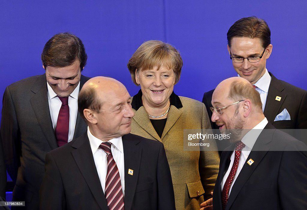 <a gi-track='captionPersonalityLinkClicked' href=/galleries/search?phrase=Angela+Merkel&family=editorial&specificpeople=202161 ng-click='$event.stopPropagation()'>Angela Merkel</a>, Germany's chancellor, back center, speaks with Pedro Passos Coelho, Portugal's prime minister, back left, <a gi-track='captionPersonalityLinkClicked' href=/galleries/search?phrase=Jyrki+Katainen&family=editorial&specificpeople=3014648 ng-click='$event.stopPropagation()'>Jyrki Katainen</a>, Finland's prime minister back right, <a gi-track='captionPersonalityLinkClicked' href=/galleries/search?phrase=Traian+Basescu&family=editorial&specificpeople=542324 ng-click='$event.stopPropagation()'>Traian Basescu</a>, Romania's president, front left, and Martin Schultz, president of the European Parliament, front right, as they gather for a family photo ahead of meetings at the European Council headquarters in Brussels, Belgium, on Monday, Jan. 30, 2012. EU chiefs arrived in Brussels to put the finishing touches on a German-led deficit-control treaty and endorse the statutes of a 500 billion-euro ($661 billion) rescue fund to be set up this year. Photographer: Jock Fistick/Bloomberg via Getty Images