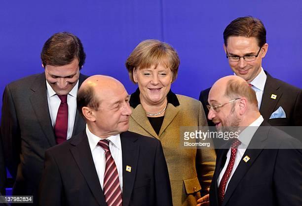 Angela Merkel Germany's chancellor back center speaks with Pedro Passos Coelho Portugal's prime minister back left Jyrki Katainen Finland's prime...
