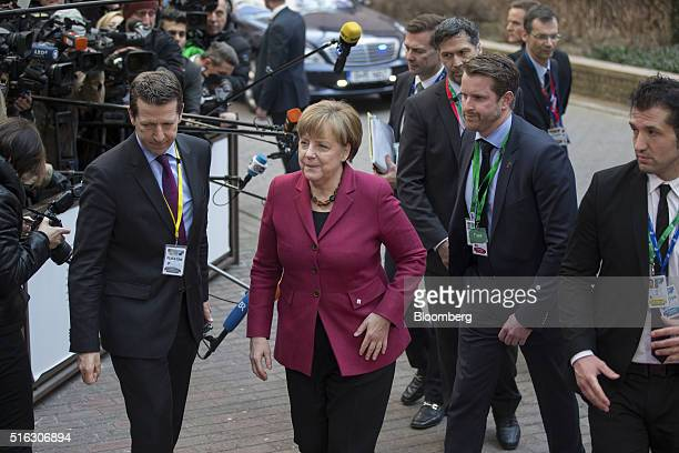 Angela Merkel Germany's chancellor center arrives for a meeting of European Union leaders in Brussels Belgium on Thursday March 17 2016 Turkey wants...