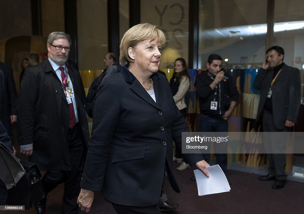 Angela Merkel, Germany's chancellor, center, arrives to speak at a news conference following the European Union (EU) leaders summit meeting at the European Council headquarters in Brussels, Belgium, on Friday, Nov. 23, 2012. European Union leaders deadlocked over the bloc's next seven-year budget, adding to the quarrels between rich and poor countries that have stymied the response to the euro debt crisis. Photographer: Jock Fistick/Bloomberg via Getty Images