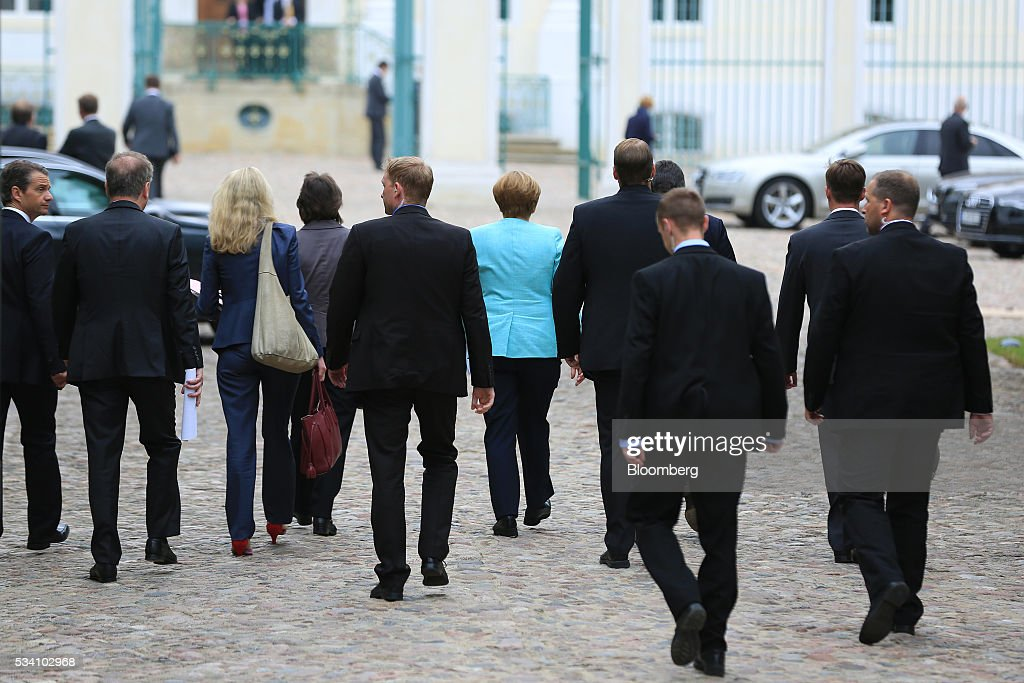Angela Merkel, Germany's chancellor, center, departs a news conference following a two-day cabinet retreat in Meseburg, Germany, on Wednesday, May 25, 2016. In the latest response to the refugee crisis that's dogged Merkel since last summer, her cabinet on Wednesday backed legislation that includes stricter requirements for asylum seekers to integrate into German society. Photographer: Krisztian Bocsi/Bloomberg via Getty Images *** Angela Merkel