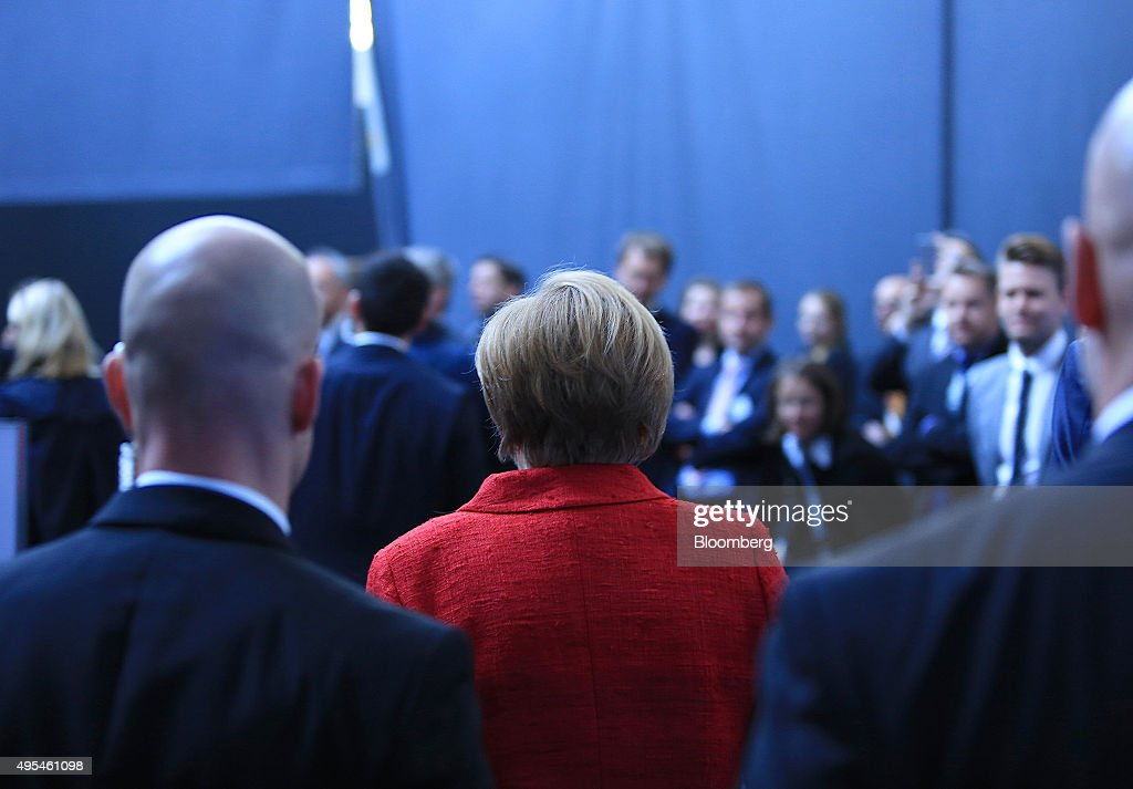 Angela Merkel Germany's chancellor center departs after addressing a BDI German industry lobby group event in Berlin Germany on Tuesday Nov 3 2015...