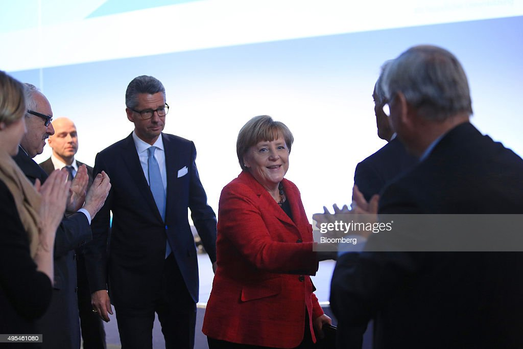 Angela Merkel Germany's chancellor center reacts as she is applauded after addressing a BDI German industry lobby group event in Berlin Germany on...