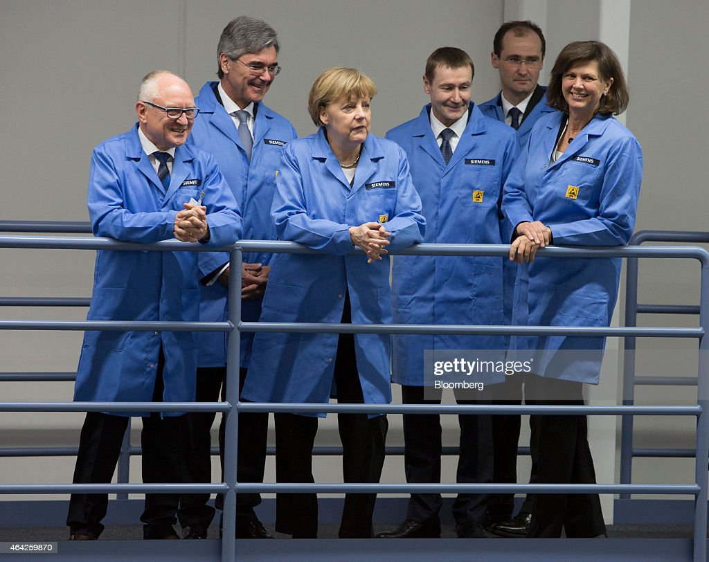 germany 39 s chancellor angela merkel visits siemens ag electronics manufacturing plant getty images. Black Bedroom Furniture Sets. Home Design Ideas