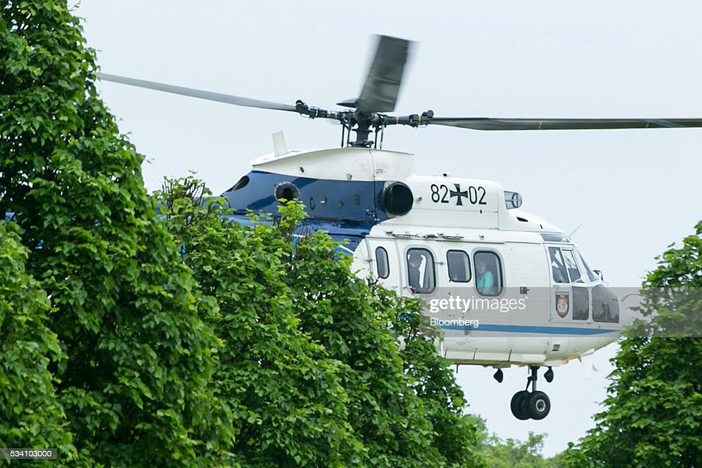 Angela Merkel, Germany's chancellor, departs via helicopter after a news conference following a two-day cabinet retreat in Meseburg, Germany, on Wednesday, May 25, 2016. In the latest response to the refugee crisis that's dogged Merkel since last summer, her cabinet on Wednesday backed legislation that includes stricter requirements for asylum seekers to integrate into German society. Photographer: Krisztian Bocsi/Bloomberg via Getty Images *** Angela Merkel