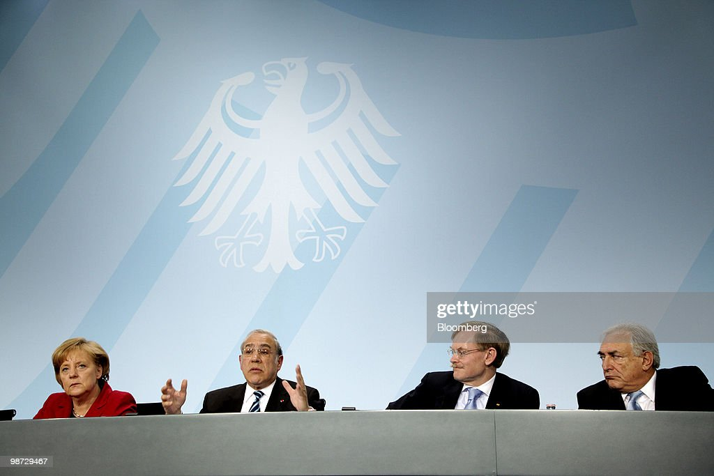 Angela Merkel, Germany's chancellor, from left, Angel Gurria, secretary-general of the Organization for Economic Cooperation and Development (OECD), Robert Zoellick, president of the World Bank, and Dominique Strauss-Kahn, managing director of the International Monetary Fund (IMF), hold a news conference at the German federal chancellory in Berlin, Germany, on Wednesday, April 28, 2010. Merkel and the IMF pledged to step up efforts to overcome the Greek fiscal crisis as Standard & Poor's downgraded Spain and investors sold bonds in Europe's most indebted nations. Photographer: Michele Tantussi/Bloomberg via Getty Images