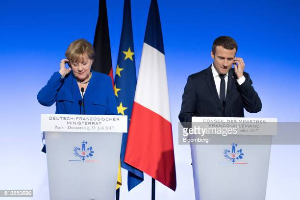 Angela Merkel Germany's chancellor left and Emmanuel Macron France's president adjust their earpieces during a news conference following a...