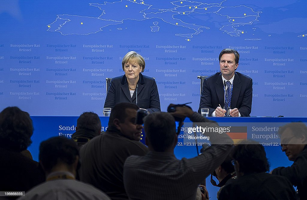 Angela Merkel, Germany's chancellor, left, speaks at a news conference following the European Union (EU) leaders summit meeting at the European Council headquarters in Brussels, Belgium, on Friday, Nov. 23, 2012. European Union leaders deadlocked over the bloc's next seven-year budget, adding to the quarrels between rich and poor countries that have stymied the response to the euro debt crisis. Photographer: Jock Fistick/Bloomberg via Getty Images