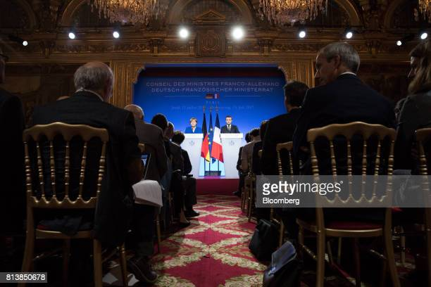 Angela Merkel Germany's chancellor left stands beside Emmanuel Macron France's president during a news conference following a FrancoGerman joint...