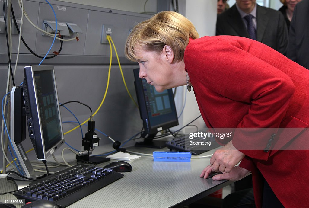 <a gi-track='captionPersonalityLinkClicked' href=/galleries/search?phrase=Angela+Merkel&family=editorial&specificpeople=202161 ng-click='$event.stopPropagation()'>Angela Merkel</a>, Germany's chancellor, looks at a computer monitor at the Merck KGaA research center in Darmstadt, near Frankfurt, Germany, on Tuesday, Sept. 23, 2010. Merck KGaA is developing liquid crystals for 3-D televisions that don't require special glasses as the company seeks to bolster sales of the fastest-growing use for the product. Photographer: Hannelore Foerster/Bloomberg via Getty Images