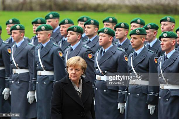 Angela Merkel Germany's chancellor passes an honor guard ahead of a news conference with Ahmet Davutoglu Turkey's prime minister at the Chancellery...