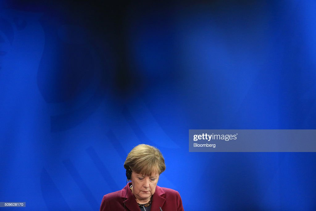 <a gi-track='captionPersonalityLinkClicked' href=/galleries/search?phrase=Angela+Merkel&family=editorial&specificpeople=202161 ng-click='$event.stopPropagation()'>Angela Merkel</a>, Germany's chancellor, pauses during a news conference inside the Chancellory in Berlin, Germany, on Thursday, Feb. 11, 2016. Iraqi Prime Minister Haidar al-Abadi said the decline in crude prices has been 'very strong' and nobody could have expected how quickly they would fall. Photographer: Krisztian Bocsi/Bloomberg via Getty Images