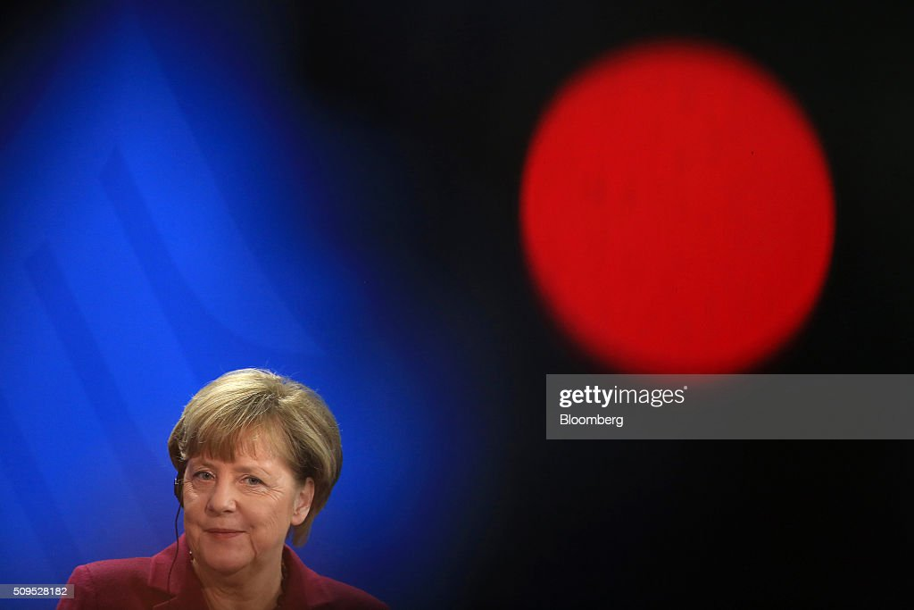 <a gi-track='captionPersonalityLinkClicked' href=/galleries/search?phrase=Angela+Merkel&family=editorial&specificpeople=202161 ng-click='$event.stopPropagation()'>Angela Merkel</a>, Germany's chancellor, reacts during a news conference inside the Chancellory in Berlin, Germany, on Thursday, Feb. 11, 2016. Iraqi Prime Minister Haidar al-Abadi said the decline in crude prices has been 'very strong' and nobody could have expected how quickly they would fall. Photographer: Krisztian Bocsi/Bloomberg via Getty Images