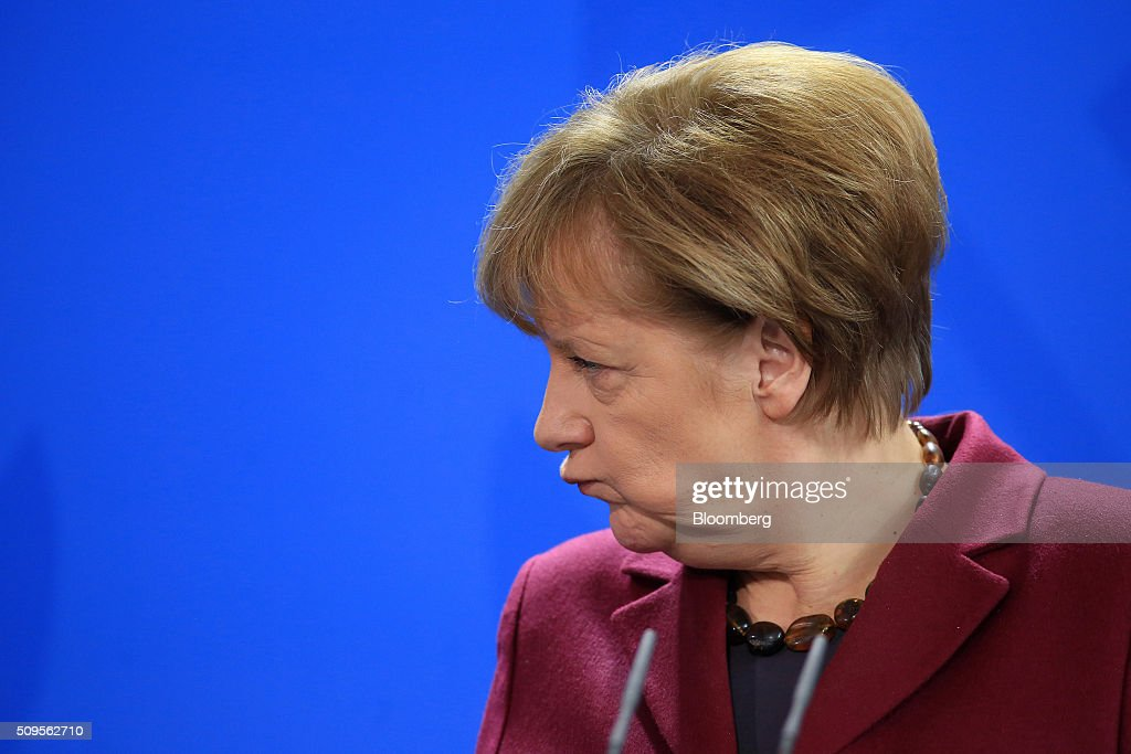 Angela Merkel, Germany's chancellor, reacts during a news conference inside the Chancellory in Berlin, Germany, on Thursday, Feb. 11, 2016. Iraqi Prime Minister Haidar al-Abadi said the decline in crude prices has been 'very strong' and nobody could have expected how quickly they would fall. Photographer: Krisztian Bocsi/Bloomberg via Getty Images