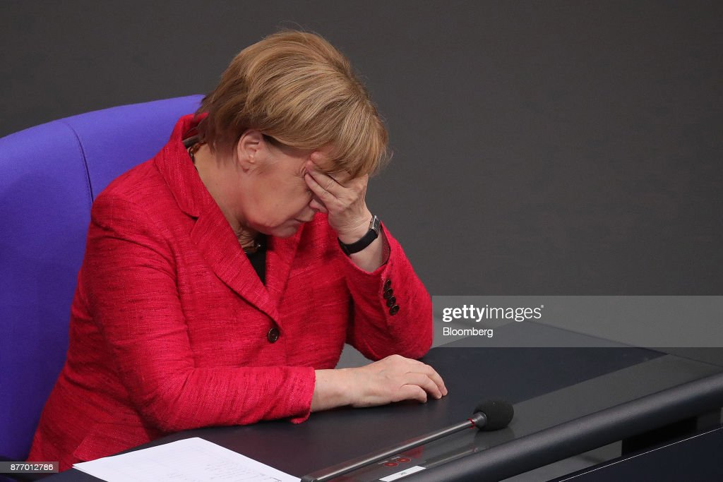 Germany's Chancellor Angela Merkel Attends Parliament As Former Partners Shun Coalition
