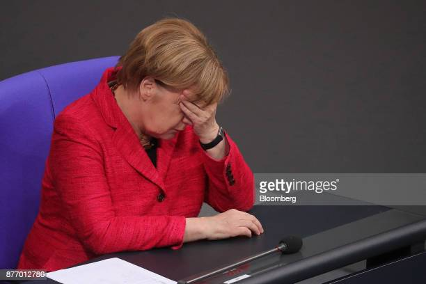 Angela Merkel Germany's chancellor reacts inside the lowerhouse of the German Parliament in Berlin Germany on Tuesday Nov 21 2017 Merkel said shes...