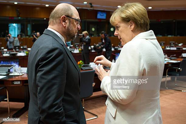 Angela Merkel Germany's chancellor right speaks with Martin Schulz president of the European Parliament ahead of a meeting with European leaders in...