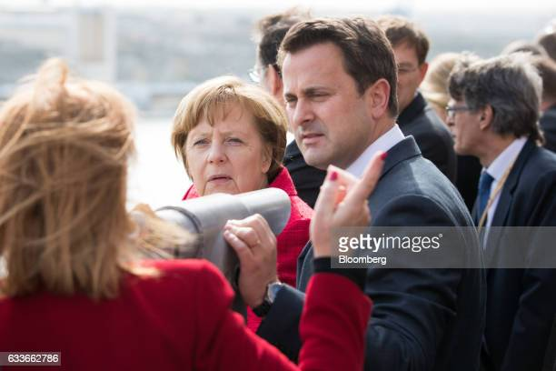 Angela Merkel Germany's chancellor second left and Xavier Bettel Luxembourg's prime minister stand beside a sightseeing telescope in the Barrakka...