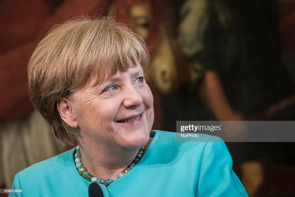 <a gi-track='captionPersonalityLinkClicked' href=/galleries/search?phrase=Angela+Merkel&family=editorial&specificpeople=202161 ng-click='$event.stopPropagation()'>Angela Merkel</a>, Germany's chancellor, smiles during a joint news conference with Matteo Renzi, Italy's prime minister, at the Chigi Palace in Rome, Italy, on Thursday, May 5, 2016. Merkel and Renzi insisted that the European Union's deal with Turkey on migrants must be implemented despite the imminent departure of the country's premier.