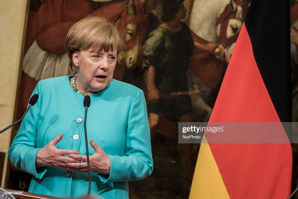 Angela Merkel, Germany's chancellor, speaks during a joint news conference with Matteo Renzi, Italy's prime minister, at the Chigi Palace in Rome, Italy, on Thursday, May 5, 2016. Merkel and Renzi insisted that the European Union's deal with Turkey on migrants must be implemented despite the imminent departure of the country's premier.