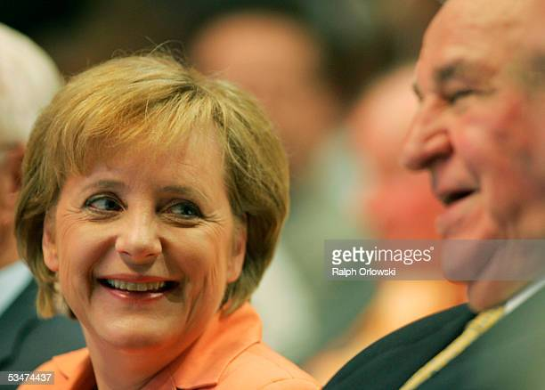 Angela Merkel head of the Christian Democratic Union and former German Chancellor Helmut Kohl attend the preelection congress of the CDU August 28...