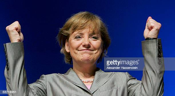Angela Merkel head of the opposition Christian Democrats the CDU raises her fists at the Lower Saxony Christian Democratic Party's annual general...