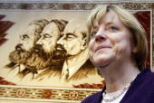 Angela Merkel leader of Germany's main opposition Christian Democratic Union party walks past the portraits of Karl Marx Friedrich Engels and...