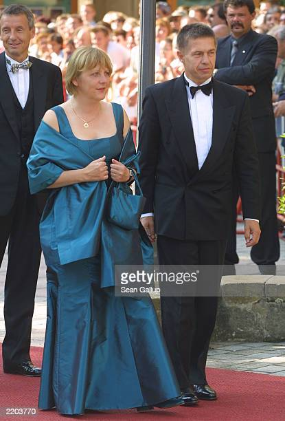 Angela Merkel leader of the Christian Democratic Union political party arrives with a friend at the opening day of the 2003 Bayreuth Festival July 25...