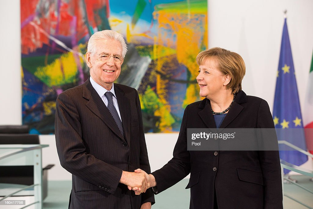 Angela Merkel shakes hands with visiting Italian Prime Minister Mario Monti during their meeting at the Chancellery on January 31, 2013 in Berlin, Germany. The German Chancellor is meeting with Italian Prime Minister Mario Monti and Spanish Prime Minister Mariano Rajoy in Berlin to hold EU budget talks in preparation for the EU Summit to be held in Brussels next week.
