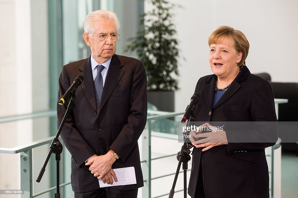 Angela Merkel speaks to the media beside visiting Italian Prime Minister Mario Monti before their meeting at the Chancellery on January 31, 2013 in Berlin, Germany. The German Chancellor is meeting with Italian Prime Minister Mario Monti and Spanish Prime Minister Mariano Rajoy in Berlin to hold EU budget talks in preparation for the EU Summit to be held in Brussels next week.