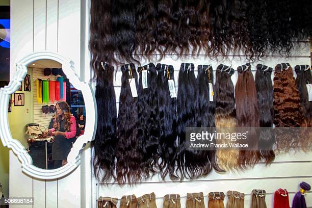 TORONTO ON OCTOBER 27 Angela Michael reflected in a mirror at her salon 4 Your Hair Extensions on Queen St W October 27 2015 For Leanne Delap story...