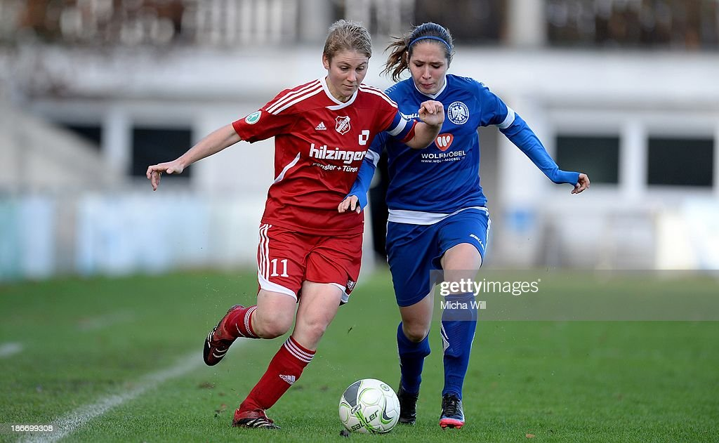 Angela Migliazza (L) of Willstaett-Sand and Jessica Koch of Wuerzburg tussle for the ball during the Women's Second Bundesliga match between ETSV Wuerzburg and SC Sand at Sportpark Herieden on November 3, 2013 in Wuerzburg, Germany.