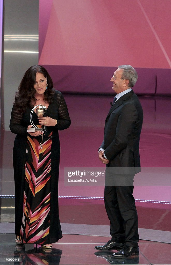 Angela Missoni (L) receives Bellisario award from Antonio Catricala (R) during the Premio Bellisario 2013 at Dear RAI studios on June 20, 2013 in Rome, Italy.