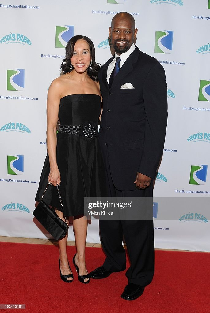 Angela Moore and Herman Moore attend 'Imagination Heals' Children's Art Launch at The Beverly Hilton Hotel on February 22, 2013 in Beverly Hills, California.