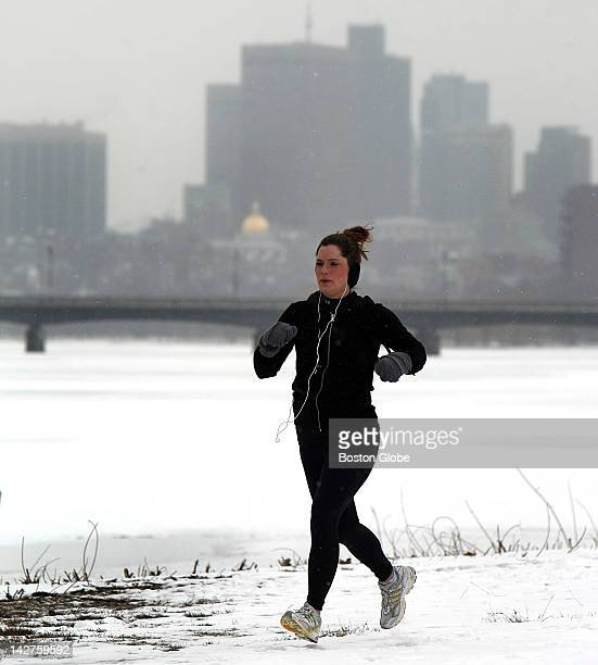 Angela Morello runs along the Charles River in training for the Boston Marathon