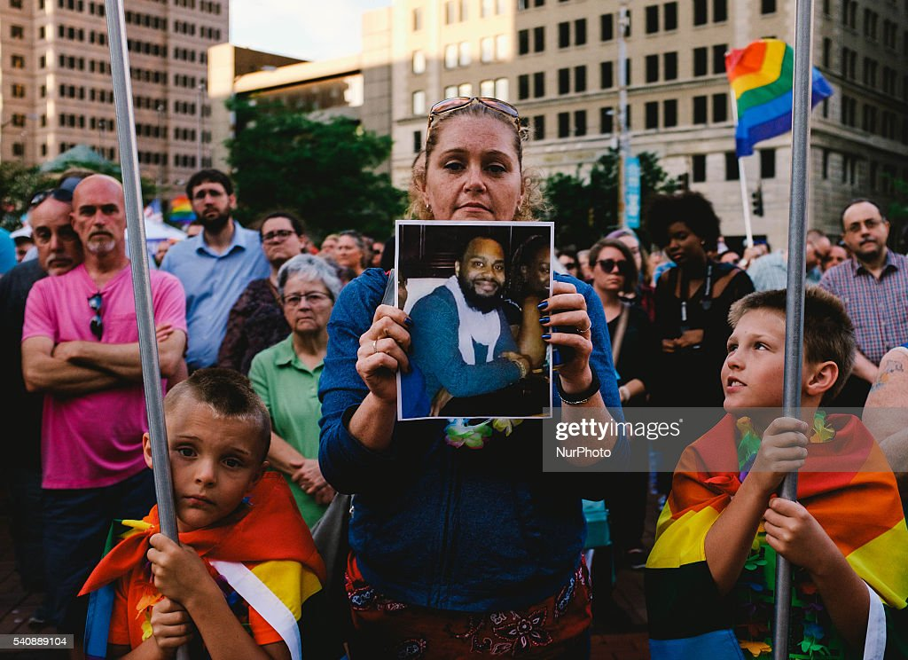 Angela Poling of Dayton, Ohio is seen holding an image of one of the victims that died at the hands of a gunman in Orlando, Florida last Sunday. Around 200 people gathered at Courthouse Square in downtown Dayton, Ohio Thursday, June, 16, 2016 to honor and mourn the lives of the lost at the Orlando shooting at Pulse Night Club that left 49 dead and several others wounded.