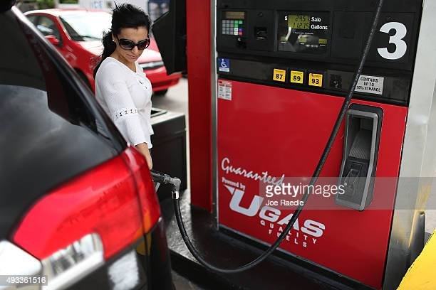 Angela Prada fills her vehicle with gas at a UGas station on October 19 2015 in Miami Florida As gas prices remain low across the nation a recent...