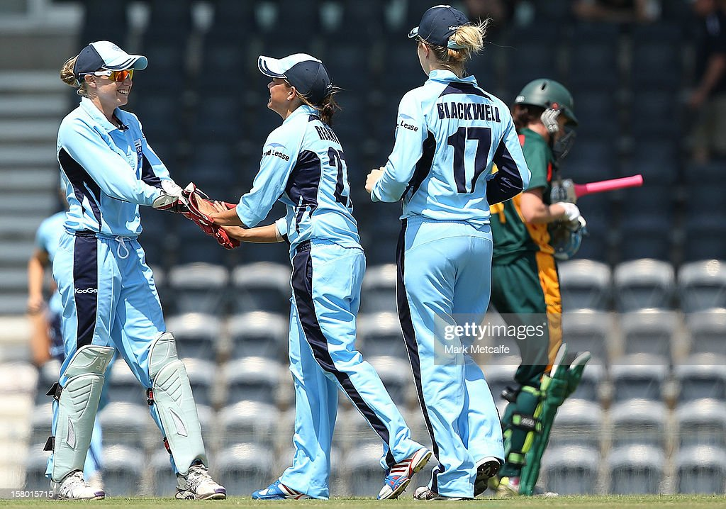 Angela Reakes and Alyssa Healy of the Breakers celebrate taking the wicket of Veronica Pyke of the Roar during the women's Twenty20 match between the New South Wales Breakers and the Tasmania Roar at Blacktown International Sportspark on December 9, 2012 in Sydney, Australia.