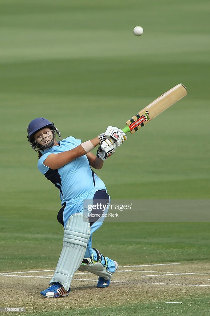 Angela Reakes of the Breakers bats during the women's twenty20 match between the South Australia Scorpions and the New South Wales Breakers at Adelaide Oval on December 23, 2012 in Adelaide, Australia.