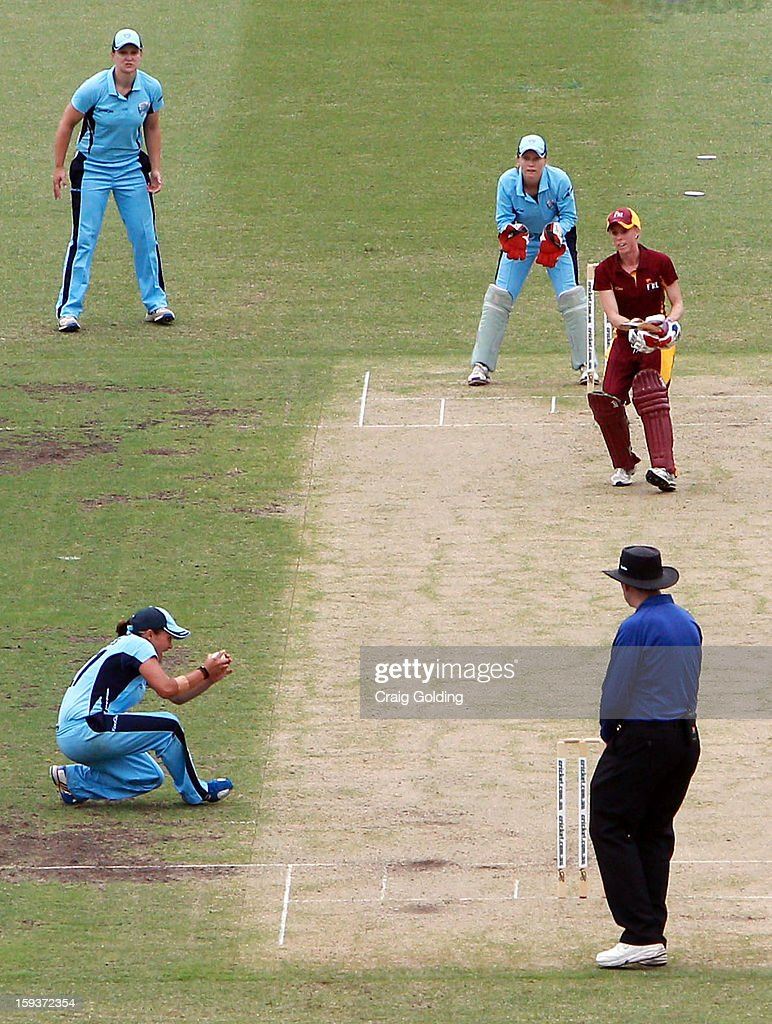 Angela Reakes of the Breakers catching Kirby Short off her own bowling during the WNCL Final match between the NSW Breakers and the Queensland Fire at the Sydney Cricket Ground on January 13, 2013 in Sydney, Australia.