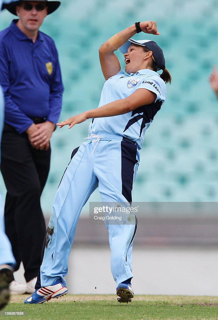 Angela Reakes of the Breakers celebrates after catching Kirby Short off her own bowling during the WNCL Final match between the NSW Breakers and the Queensland Fire at the Sydney Cricket Ground on January 13, 2013 in Sydney, Australia.