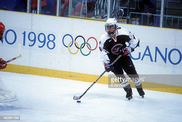 Angela Ruggiero of Team USA skates with the puck during the women's first round match against Team China at the 1998 Nagano Winter Olympics on...
